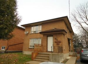 WELL MAINTAINED ALL BRICK TRIPLEX! AMAZING INVESTMENT POTENTIAL!