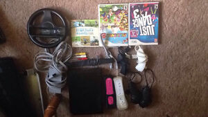 Nintendo Wii +Games and Accesories. Willing to negotiate price.