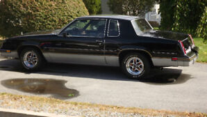 1986 CUTLASS   442  ( OFFERS AND TRADES CONSIDERED)