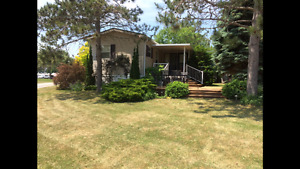 FULLY FURNISHED COTTAGER ON WEST LAKE...PREMIUM LOT!!!