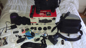 Mint Canon EOS T3i , 3 lenses , 2 Low Pro bags, 3 batteries etc.
