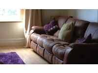 Settee and rocking arm chair mock suede.