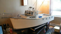 RC tuna boat willing to trade for a inflatable zodiac style boat