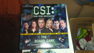 CSI board game + booster pack (new in boxes)