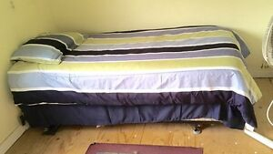 Single new bed with brand new sheets !