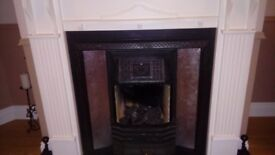 BLACK AND SILVER FIREPLACE SURROUND