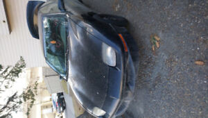 1997 pontiac sunfire with another set of tires and rims