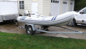 REDUCED.  INFLATABLE 11 FT. BOAT WITH MOTOR AND TRAILER,
