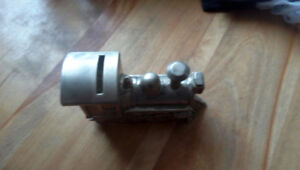Vintage silver plated zinc train change bank.