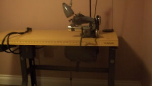 Industrial sewing machine a blind hemmer
