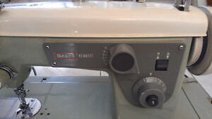 Vintage Kenmore sewing machine with case.