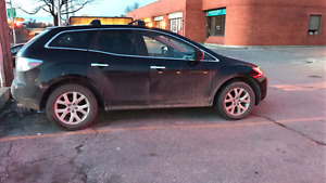 2008 mazda cx7 with WARRANTY . Must sell by tuesday $6000