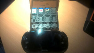 PS Vita slim - 2x8 GB memory cards, 3 games, and accessories!