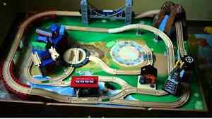 Imaginarium train table with extra trains and rails