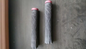 Black scooter grips and purple bar ends