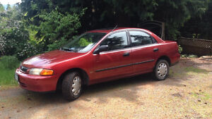 $1,500 · 1997 Mazda Protege** Very Reliable!