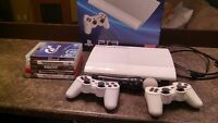 PS3 500gb Presque Neuf + 5 Jeux, 2 manettes, PS Move, Camera.