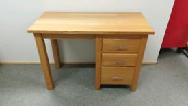 Light oak three drawer desk