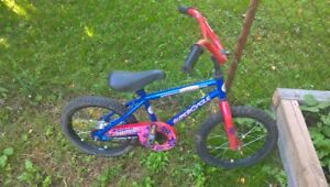 red and blue boys bike