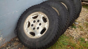 """4 GM Wheels 16"""" with tires."""
