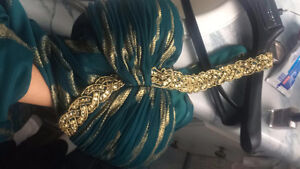 beautiful dark teal and gold dress with gold strap around neck
