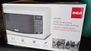 NEW, never used white RCA microwave