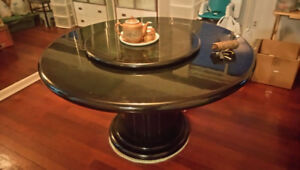 Dining table with rotating center piece