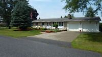 3 bedroom bungalow with finished basement and 2 garages
