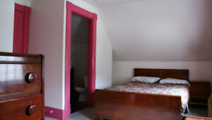 Furnished bedroom with private bath