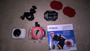 Polaroid waterproof action camera complete with accessories