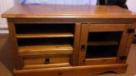 TV Unit. Wooden tv unit with glass door.