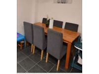 Dinning table with 6 chairs only 1 year old