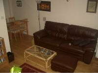 Brown leather sofa and foot stall (with storage) for sale
