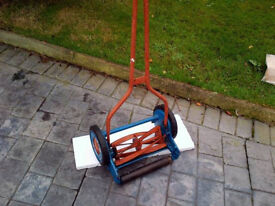 Vintage antique retro lawnmower with grass box