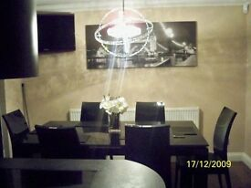 Selling a gorgeous black gloss dinning table and chairs with Swarovski crystal