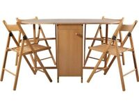 Drop leaf table, folding chairs and seat cushions