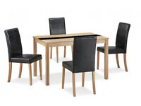 ASHFORD ASH VANEER & BLACK GLASS DINING TABLE & 4 BLACK FAUX LEATHER CHAIRS
