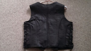 Geniune leather vest, lined. Fits more like 14-16