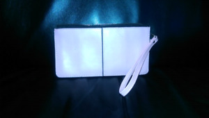 Leather wristlet and white leather clutch