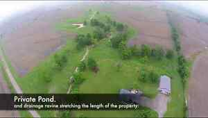 NEW PRICE! 100 Acre Farm with House and Shop