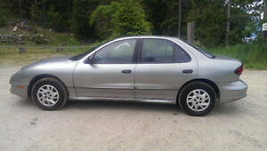 Pontiac Sunfire with Set of Winter Tires on Rims
