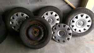 4 winter tires on rims and wheel covers.