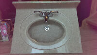 Stone vanity counter top with integrated sink