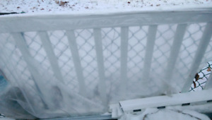 One section of white composite plastic deck railing