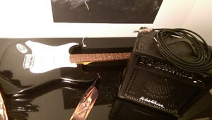 LEFT HANDED black electric guitar with amplifier