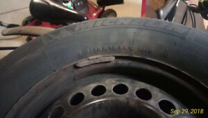 A set of four 215/70 R 15 98 Q Michelin winter tires with rims