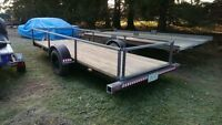Newly refinished 5x15 single axel utility trailer with brakes.