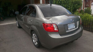 2010 Kia Rio EX Auto Sedan (includes winter tires on rims)