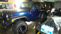 2002 Jeep TJ Sport - M.V.I. AND LUBE, OIL AND FILTER  MAY 21/15