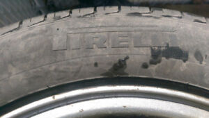 Pirelli P4 205/55/16 tires and Subaru Mags in good condition